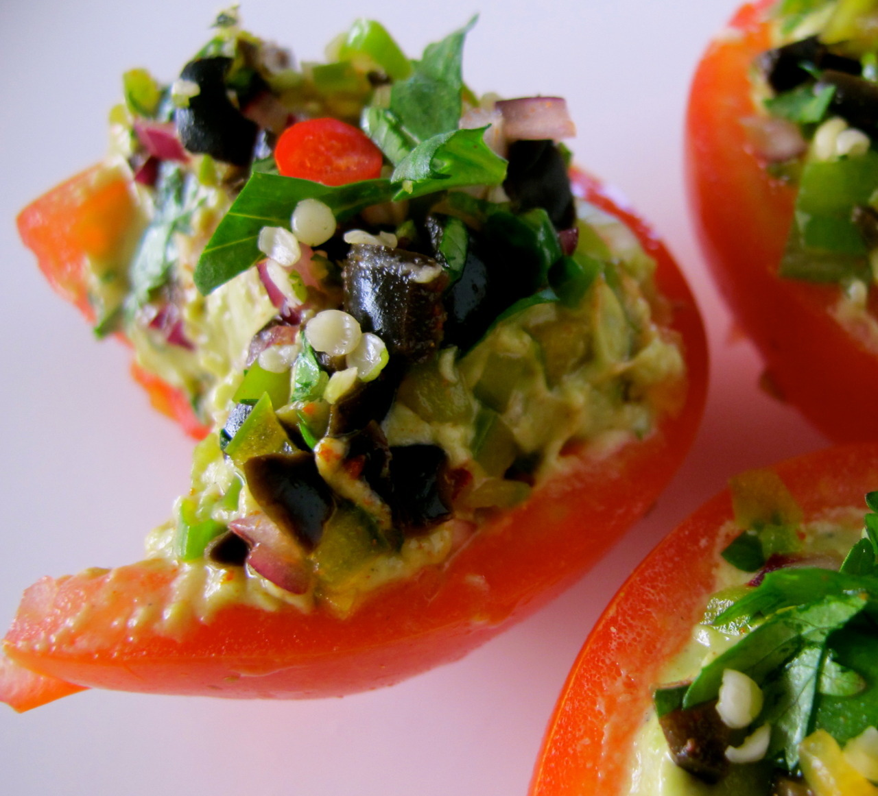 queenbliss:  raggedyshan: Raw Protein Guacamole & Salsa Stuffed Tomatoes… Ingredients:    - 3 Medium Tomatoes    - Hemp Seeds (to garnish & add additional protein) Protein Guacamole:    - 1 Ripe Avocado    - 1 tbsp Raw Protein Powder (plain unflavoured)    - 1 tbsp Olive Oil (cold press)    - 2 tsp Ground Cumin     - 2 tsp Apple Cider Vinegar    - 1 Pinch Celtic Sea Salt    - 1 Pinch Ground Black Pepper Green Salsa Topping:    - 1/4 Red Onion (diced)    - 1/4 Green Capsicum (diced)    - 1 heaped Tbsp Black Spanish Olives (diced)    - 1 Sprig of Spring Onion (finely chopped)    - 1 Tbsp Cilantro (finely chopped)    - 1 pinch of Smoked Paprika    - Juice of half one lime Instructions:    1. Cut tomatoes in half, and scoop out centres     2. In a food processor add all your guacamole ingredients and blitz until smooth and creamy    3. Prepare all your salsa ingredients in a mixing bowl, and mix when finished    4. With a spoon divide the guacamole into the 6 tomatoes halves and fill    5. Top guacamole filled tomato's with your salsa until all are evenly dispersed    6. Lastly sprinkle with hemp seeds to garnish These are a GREAT Quick bite, fresh packed lunch, or even just an afternoon snack. They are great to look at, and so tasty! I'm always trying to amp up my protein as I eat a lot of raw foods. The protein guacamole is such a great way to do that, yet stay clean and green! I hope you enjoy these as much as I did!