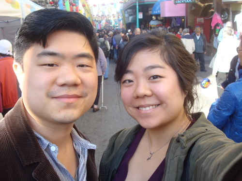 On January 14th, 2012: With my brother in SF's Chinatown, on the first day of a month-long celebration of the new year! It's hard to tell but there are THRONGS of people behind us (and in front of us).