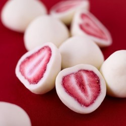 chanelbagsandcigarettedrags:  strawberries dipped in yoghurt then frozen