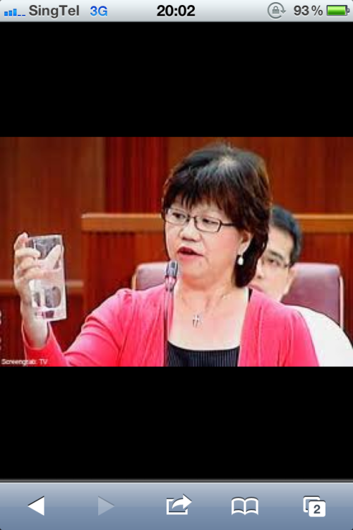Denise Phua looking at a glass of water