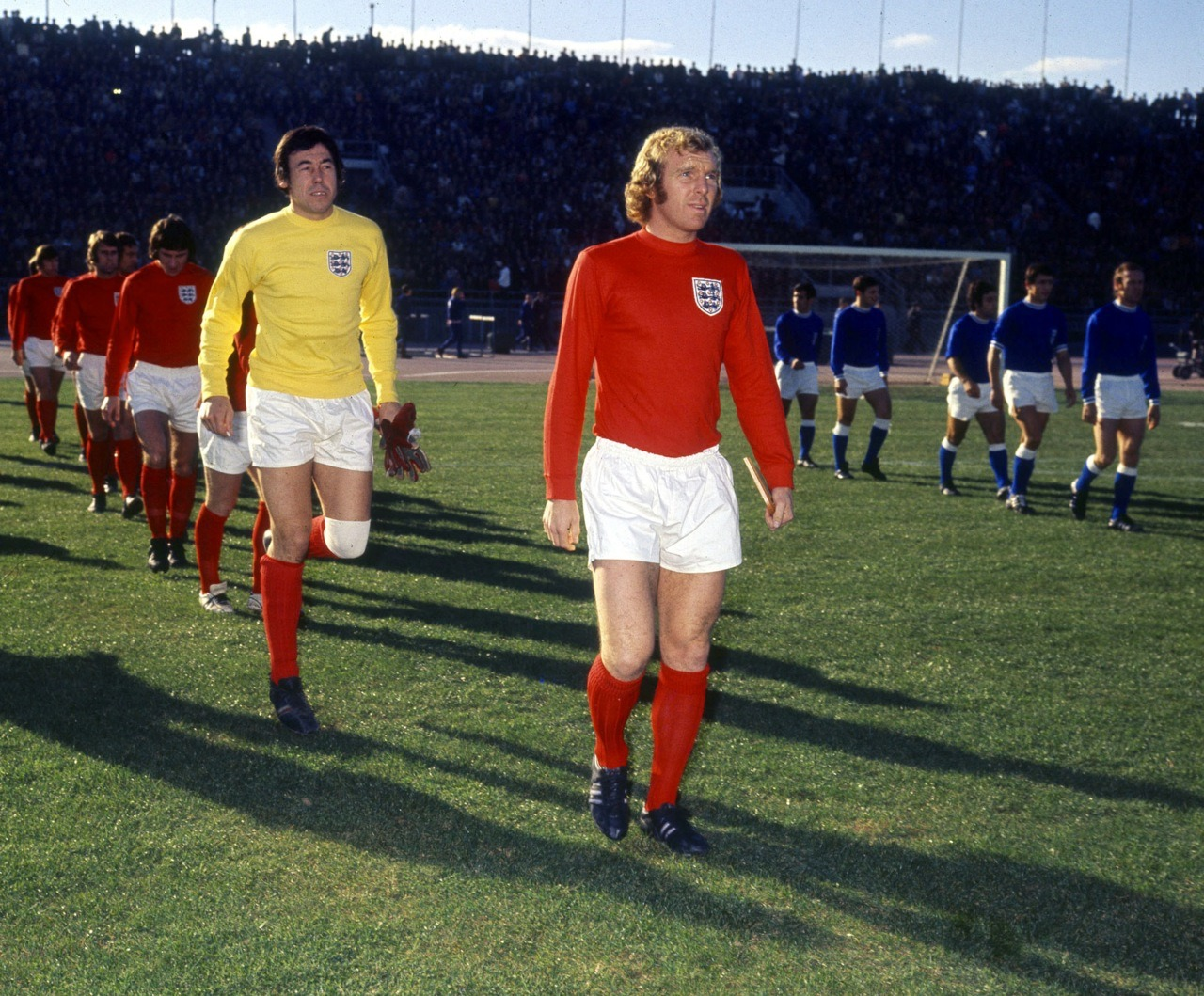 Bobby Moore, leading England out in the early 1970s.