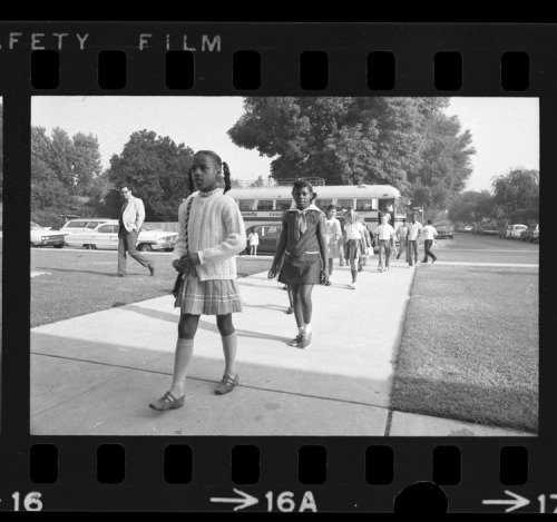 The first black students to attend Plymouth School (Monrovia, CA) arrive by bus with others as district integration plan went into effect. 1970