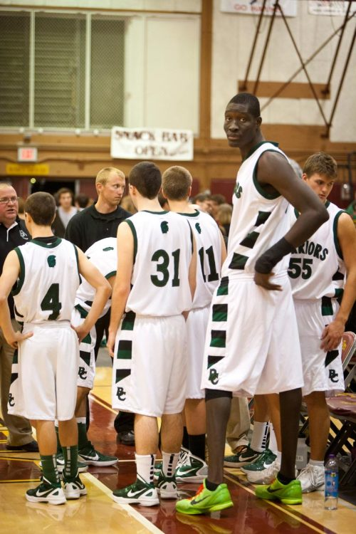 "All eyes are on this 7-foot-5 basketball star, but Mamadou Ndiaye is still a junior at Brethren Christian High School in Huntington Beach, Calif. The college scouts — and Guinness Book of World Records! — might have to wait a year or two.  The 18-year-old native of Senegal stands 7-foot-5, weighs 310 pounds and wears size 19½ lime green Nike Zoom Kobe VI shoes. At 89 inches, Ndiaye is two inches taller than anyone currently toiling in the NBA even though he plays for a tiny private school (enrollment: 250) that currently does not even have its own gym. While his stats may be skewed due to the Warriors competing in California's third-smallest class (5-AA), Bahnsen has little doubt that his player who ducks through doorways has an unlimited ceiling. ""Right now his game is basically catch, turn, drop-step, dunk,"" says the 5-foot-11 Bahnsen, whose own college coach was a 7-footer from a foreign country, former NBA center Swen Nater of the Netherlands. ""But this kid's going to play professionally some day. The minute Mamadou enrolled I became a much better basketball coach.""  Photo: John Chapple for The Daily"