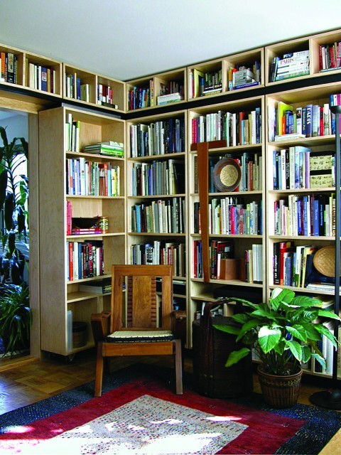A home library features a sliding door that is, in fact, made up of another (rolling) bookcase. When closed, the entire room is walled in with books. (via Gardner Mohr Architects LLC)