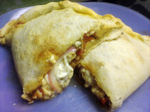 reblogged from detroitdomestic:    Dinner last night: (vegan) calzone.  Almost all ingredients are homemade: the dough, the sauce, and the veggeroni (seitan pepperoni) that you can't see behind all the melting Daiya cheeze…