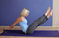 Daily Pilates Pose 32: The Boomerang 1. Sit tall with straight legs and cross your right ankle over your left. Press your hands into the mat on either side of your body to help lift you out of your hips. 2. Inhale and roll back until your legs are overhead. Do not roll onto your neck. 3. Hold this position steady, exhaling as you open and close your legs in a snapping motion, recrossing your ankles, now with left over right. 4. Inhale and roll up into your V position, bringing your arms forward to your toes. 5. Balancing in this position, bring your arms down and around to the sides of your body, clasping them together behind your back and stretching them away from your torso. 6. Slowly, and with great control, exhale and begin leaning forward until your legs touch the mat and your nose is on your knees in a deep bow. 7. Keeping your arms lifted behind you, gently unclasp your hands and circle them forward to your toes. 8. Complete 2 sets, switching ankles each time. Initiate from your core, keeping your body stiff so your movements do not get sloppy.