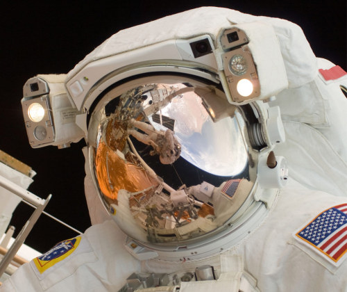 crookedindifference:  Astronaut John Grunsfeld performing a spacewalk to work on the Hubble Space Telescope