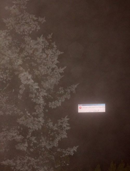 A foggy night in Odessa, Ukraine, when a digital billboard crashed and displayed a floating error warning in the night sky.