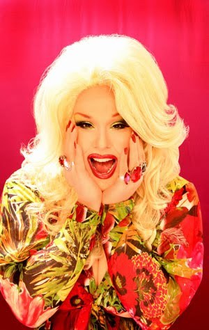 "SassySays.com - Drag History Month - January 20, 2012 - Sweetie          Sweetie, an accomplished entertainer, hostess, and whore, Sweetie is New York's ""big-titted honkey soul momma."" A daughter of the unforgettable drag houses Pyramid and Boy Bar, she has enjoyed success as an iconic club performer, cable television star, stage and motion picture actress, and mother of the infamous tranny fest QUEEN BEE.    Sweetie gained notoriety at JACKIE 60 as a writer and actress for her irreverent portrayals of tragic billionairess Christina Onassis, social outcast Big Sue, Appalachian earth mother Vernell Puckett, and 1980s fag-hag Heather Peleshock. As a golfclub-wielding ""Patsy Ramsey"" in the Jackie's Playhouse presentation of Daddy's Little Prostitute, Sweetie was seen by millions on the sensational tabloid news program Hard Copy (footage smuggled out by reporters with live cameras in their baseball caps.) As well as live theatre pieces, Sweetie is also touted as one of New York's most heart-wrenching lip sync artists.      Sweetie has appeared in the Motion Pictures: Too Wong Foo, Thanks for Everything Julie NewMar and Starrbooty. As well as the television series ""Faking It"" and ""Project Runway."" She is the hostess for the Off-Broadway hit show: The Ultimate Drag-Off."