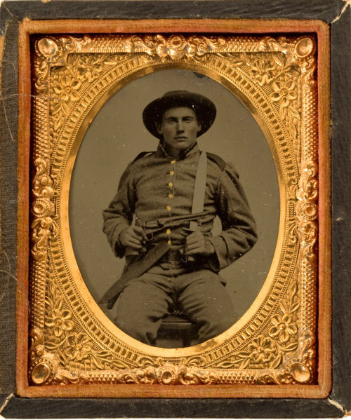 tuesday-johnson:  ca. 1860's, [tintype portrait of Confederate Infantryman armed with a revolver and Bowie knife] via Heritage Auctions
