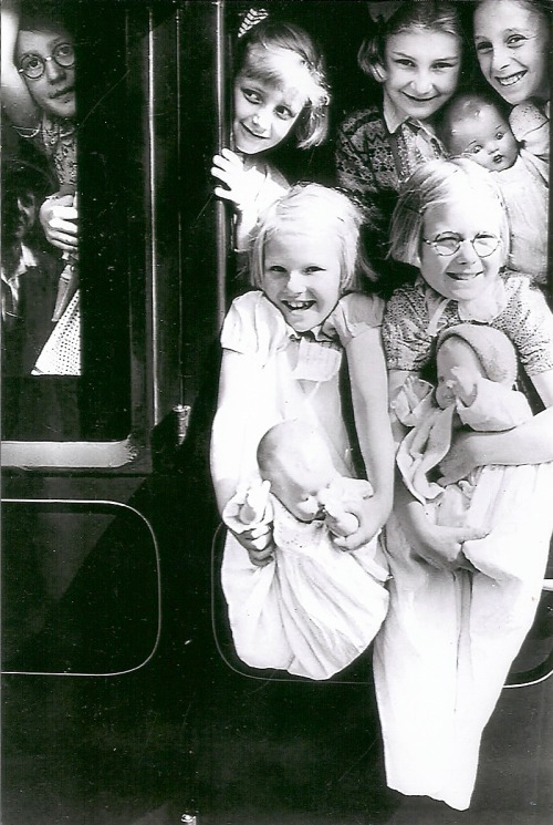 This is my two older sisters being evacuated to Wales from Gillingham, Kent, England during World War II. They are the two in the front holding their dolls. I was too young to go with them. Florence Keels