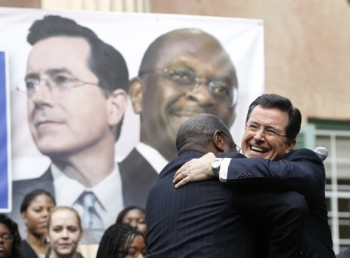 washingtonpoststyle:  Today, in one image. Cain. Colbert. God bless America. Photo by Jason Reed (Reuters)