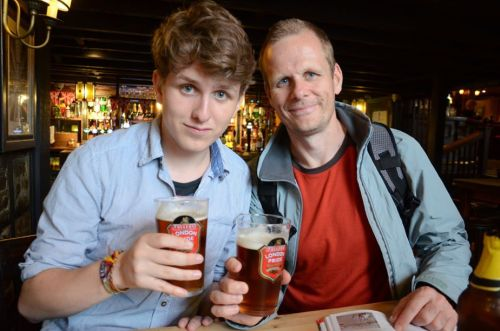 "lifestartsatsixty:  My Father and I having a traditional London Pride in the Anchor Pub near Shakespeare's Globe.  Cheers to my new followers, As much as I pretend I could 'give a shit' about people taking an interest in me, I cannot deny it is nice to be noticed. Since I've accumulated a number of new followers who only know me through the internet, which I cannot lie worries me a little, I thought I'll tell you a little bit about myself. This isn't an invitation to look me up, and use my personal details in an attempted to trick your skeptical colleagues that you have a ""boyfriend."" I am a first year history major at York University in Ontario. Although York isn't a school known for history geniuses such as myself, I only plan to do my undergraduate degree here and go to graduate school at a more respectable and a less self-righteous-socialist hippy breeding institution. All joking aside, I am very happy with my classes and I'm grateful for a chance to have a post-secondary education, which I hold to the highest importance. Born in England, with a Welsh-Irish heritage I embrace my background quite a bit; I enjoy all the traditional foods and drinks, including Earl Grey tea and a nice pint of British Ale. I grew up in a nice part of England, in a small town in Gloucestershire and I have fond memories of the place. My family and I visited Canada when I was eight, and I love it so much we decided to live here (I believe its because of the nicer people). Apart from history I have a number of other interests, a lot of which pop up on this blog from time to time. This includes beer tasting, swimming, cycling, theater, comedy and as my friend Caitlin would put it ""being overly pretentious.""   Feel free to exercise your curiosity and ask tons of questions, whether history or non-history related I'll do my best to answer them thoroughly and as quick as I possible.   This is me, on my other blog. It's a bit more personal, I'm sorry I haven't put anything up on my shark one in a while. My only explanation is I'm a male and I cannot multitask. Nevertheless I still love sharks, and I'm really impressed with some of the shark blogs tumblr holds, I just fail to keep up. Sorry. So if you want to know the bit more personal side of my life, surrounded by history then follow me at lifestartsatsixty.tumblr.com"