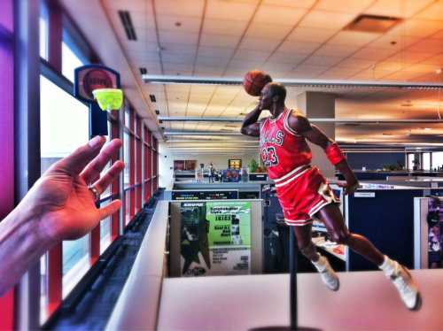 My co-worker bought a Michael Jordan figurine. I had a small basketball rim. Our re-enactment of the 1988 Slam Dunk Competition.