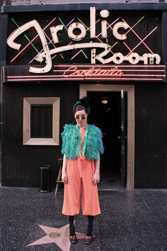 My sister Kit in front of the Frolic room in LA. Clicking the image takes you to her blog.