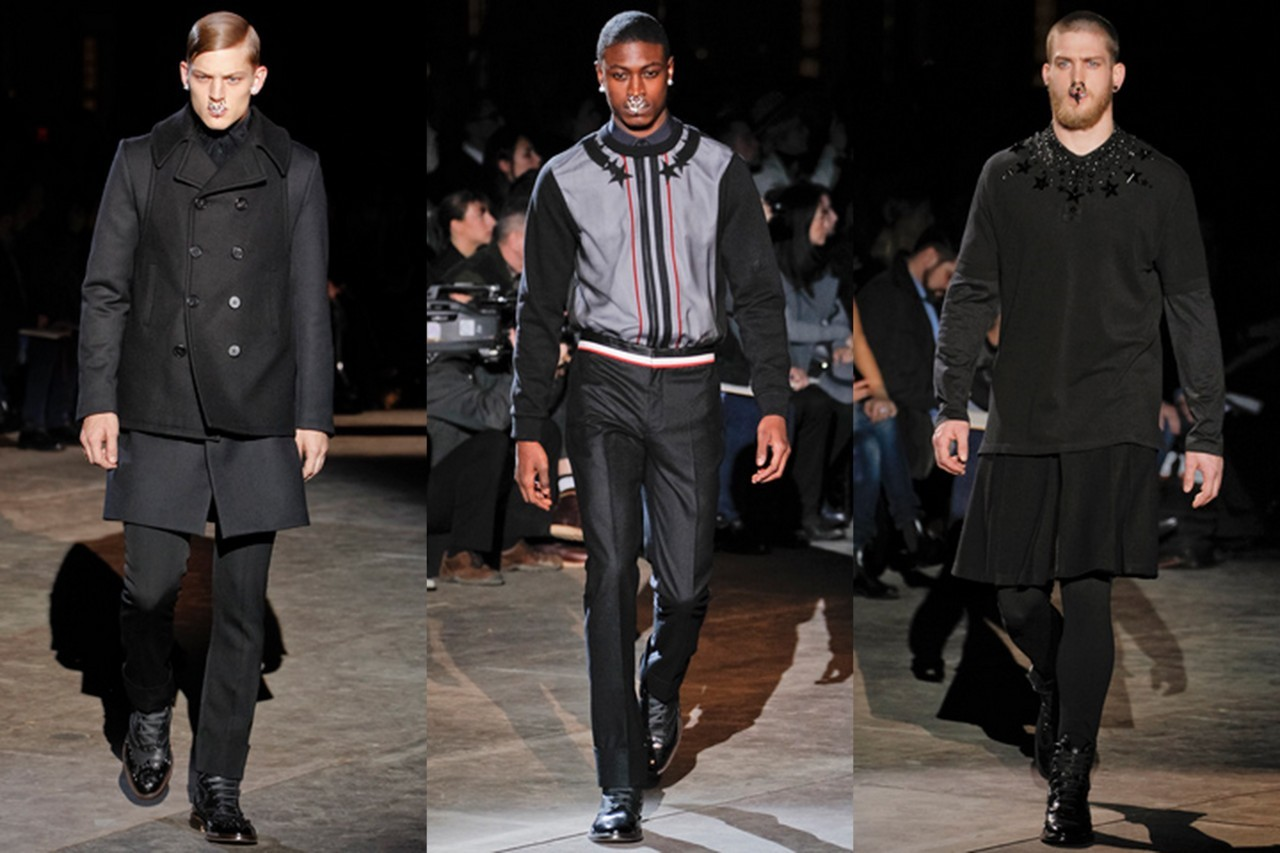 Givenchy Menswear Fall Menswear 2012 Youthful rebellion has been a lesser theme in the past collections. Everyone has decided to grow up a little with suits and dark tones. But Tisci's latest Givenchy collection isa strong rejection against age. Through motifs like censorship, youth, and rebellion, Tisci achieves a defiant yet fabulous effect. The first element to notice about the gothic use of black. At first, the color seems to fit into the mold cast by equally sinister collections, like Ferragamo of Milan and Yves Saint Laurent of the same day. But as the progression mounts, the idea of censorship seems to takeover. There are many small details in this collection, and on the most important is the patent leather American flags. While the colorful stars and stripes appear elsewhere, the initial looks featured suits with blacked-out hues on flags. A sense of the young rebel as Tisci's man came into play with the development of other images, such as the extreme nose piercings and black boots that recall something out of the skinhead look of the 1980s. To add lightness, Tisci smartly added a healthy serving of skirts and leggings, a bit of a juvenile quirk. In a way, this collection was a manifesto, a defiance of the consistent, conservative look shown in Milan. Looking deeper, it seems that Tisci aimed for a political message through his selections: revolution fare. As SOPA and PIPA are protested online and as the world remains in uncertainty, Tisci's collection was especially relevant.