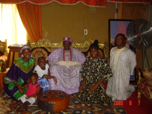 thegoddamazon:  Me and my family with the King of Osogbo, Nigeria. He is the one that gave my mother permission to hold the Osun Festival here in the States. Also the same year she gained her Chieftancy in Okpella. Huuuuge festival. Lots of food, singing, and teasing from the Elders.