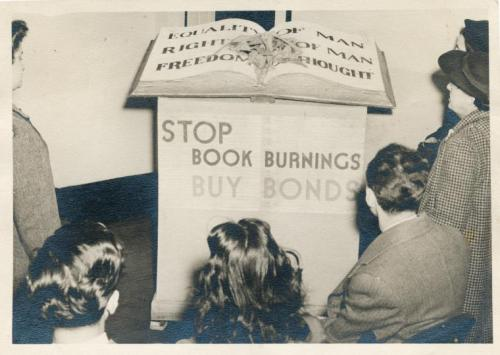 "Vintage photo from the New York Public Library: nypl:  ""Stop Book Burnings."" Emphatic words from a 1942 exhibition presented by the Muhlenberg Library on W. 23rd Street."