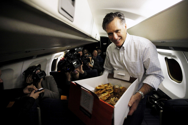 "motherjones:  hollybailey:  Mitt Romney will NOT REST until you eat a pastry. Here's an excerpt of a Phil Rucker's pool report from a flight between Charleston and Greenville Friday:  Before take off, Mitt Romney walked down the aisle with a large box of assorted pastries from Panera Bread to pass out to the passengers (including the governors and press).What follows is a transcript of his exchanges.""Come on, Kasie, dig in,"" Romney said to Kasie Hunt of the Associated Press. ""Pain au chocolat. Smart move.""""Ashley?"" Romney said to Ashley Parker of The New York Times.""Can you just grab me something?"" Parker asked, turning to her seatmate, Kasie Hunt, who was holding the tongs poised over the basket.""What do you want though?"" Romney asked.""Um…"" Parker said. ""The popover thing?""""The popovers?"" Romney asked.""Thank you very much,"" Parker said.""Sticky bun?"" Romney asked other reporters. ""There you go.""""Snack time! Nothing? Just, you know, use your fingers,"" Romney said, struggling with the big box. ""The heck with this. There you go.""""Come on, Emily, dig in here,"" Romney said to Emily Friedman of ABC News. ""Fingers are fine. We're among friends.""""Sarah, you want one? What do you want?"" Romney said to Sarah Boxer of CBS News.""I don't know,"" Boxer said. ""What's in there?""""We're gonna solve problem one here by getting rid of these ridiculous things here,"" Romney said, handing two pairs of black plastic tongs to the flight attendant behind him.""Rucker, come on Rucker,"" Romney said to Philip Rucker of The Washington Post. ""Oh, he makes a good move for the cheese. Take two.""""No, no, no,"" Rucker said.""Look it, there's so much in here,"" Romney said. ""Come in, take more. No, take more than one. Take two, take two, Ruck-man. Come on.""""Where'd you get it?"" Matt Viser of The Boston Globe asked Romney, referring to the pastries box.""We found it on the floor up there,"" Romney said.""Do you want another one?"" Romney asked Sara Murray of The Wall Street Journal.""No, I'm good, but thank you,"" Murray said.""Who wants some more of these?"" Romney said. ""Look at this. This is good stuff. This is from Panera. Very high-end.""""Pain au chocolat in there,"" Romney continued. ""Look at the sticky buns. Those are the best.""""Hey, Rucker, there's still some more of those cheese cake babies in here,"" Romney continued. ""No? You only had one of these. Come on, Ashley.""""Alright,"" Romney said. ""We've got to get seated.""  ""Look at the sticky buns. Those are the best""—amazing. (Photo: Charles Dharapak/AP)  Yup."