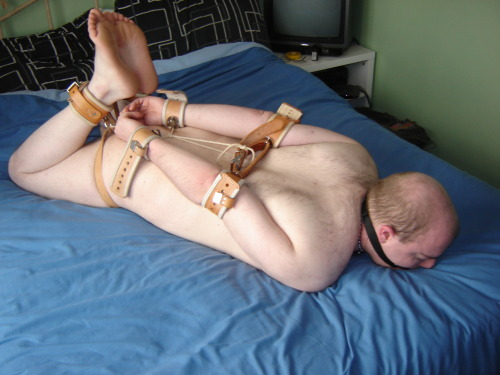 Hogtied and gagged in locking medical restraints