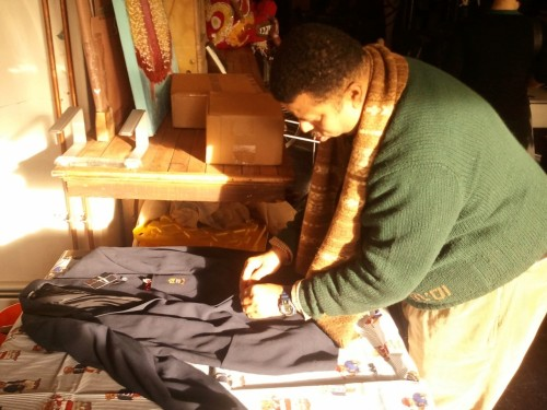 Dallas Penn adjusts a few of the 1000+ pieces in his Polo collection before our interview for Put This On season two.