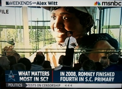 AAAAAAAHHHH WHAT ARE YOU DOING IN FRONT OF THAT GIANT BLACK MONSTERBABY, MITT ROMNEY?