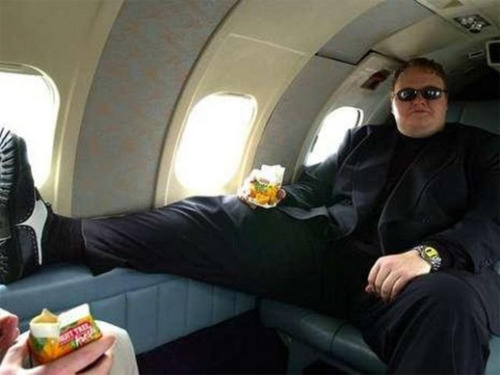(read about) The Notorious Cyber King - Megaupload founder Kim Dotcom In the Wild, Wild West-era of digital media, there is no cowboy quite like Kim Dotcom. Part Sean Parker, part Kevin Mitnick, with a whiff of Notorious B.I.G., Dotcom embodies the most savage age of online piracy, having made a fortune on the edges of Internet freedom. Dotcom, the megamind behind Megaupload, was arrested yesterday in New Zealand, his panic-room door busted down by officials, who found the hacker clinging to a sawed-off shotgun. Dotcom faces up to 55 years in prison if extradited to the U.S. and convicted on charges of racketeering, copyright infringement, and money laundering. The hacker-turned-multimillionaire businessman has been accused of costing the entertainment industry $500 million through pirated content uploaded to his popular file-sharing site, which boasted 180 million registered users and celebrity endorsements from Kanye West to Kim Kardashian.  Read on->