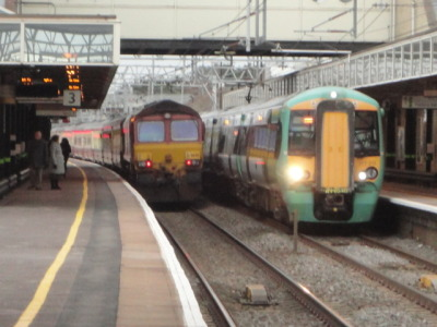 The Concrete Cow railtour, pulled by two Class 66 EWS Freight loco's, seen beside a Southern Class 377 Turbostar, at Milton Keynes Central. Taken by me on 21-01.