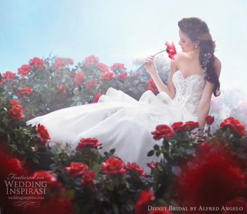 i simply adore the idea of a bridal collection inspired by the disney princesses! here's a dress inspired by belle. <3