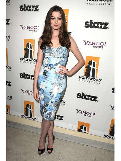 Trend-spotting: Take a cue from Anne Hathaway and try a form-fitting floral frock for prom this year. Get more style inspiration from your fave stars here »
