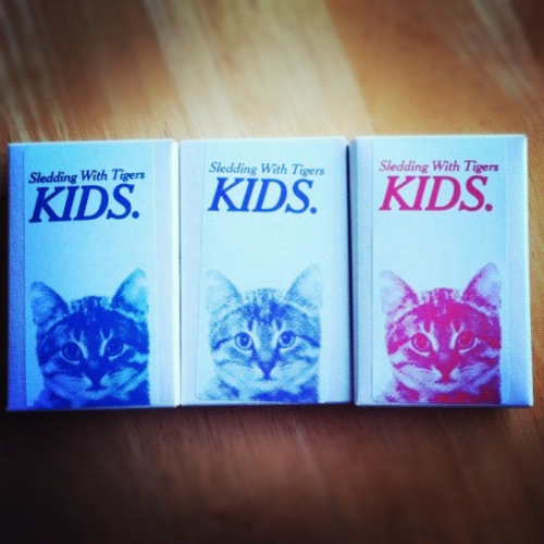 Get your Sledding With Tigers/KIDS  split cassettes, and make haste for there are only 50 made!