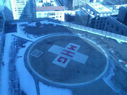 Helicopter landing pad at Massachusetts General Hospital. Had a delivery way up on the twentieth floor yesterday. Insanely slow elevators there. And then on the way down, I shared the elevator with an old guy in a wheelchair who was being escorted by two MGH police officers and two Middlesex County Sheriff's officers. That was unusual.