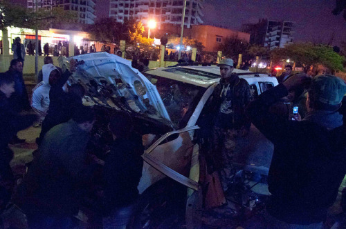 Benghazi on Flickr.Benghazi, 21/01/2012 - Protestors destroy a vehicle said to belong to NTC Chairman Mustafa Abd-al-Jalil outside the NTC HQ in Benghazi.