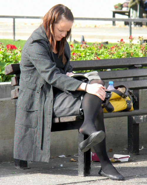 woman sitting reading book marble arch westminster London 7th October 2010 14:09.56pm by dennoir on Flickr.