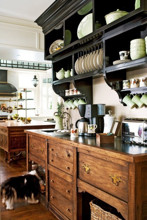 bringing-preppy-back:  georgianadesign:  Antique hutch inspired coffee bar. Designer Joan Nemirow in Traditional Home.    The dog in the corner