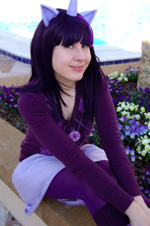 Twilight Sparkle 3.0! I wore this to Sukoshicon in Destin recently. I used my ears and horn from Yaya, my second wig, an awesome sweater I found, a new necklace and skirt I made, a couple bits I had already, and stripey socks from Sock Dreams.