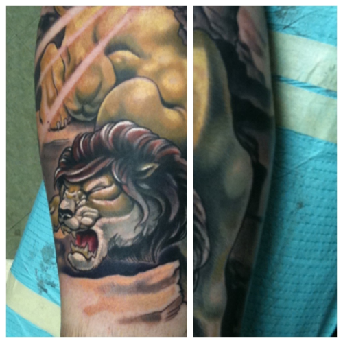 A lion in his den. This was done by Kurt Fagerland in ATL. Go get tattooed by him.