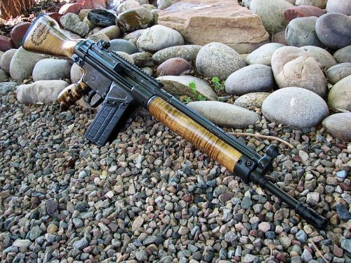 gunrunnerhell:   Custom Century Arms CETME (Built by a guy I know, it has custom wood furniture with laser engraved markings, a picatinny rail atop the receiver, shell deflector and a G3 rear sight instead of the standard paddle sights on a CETME)