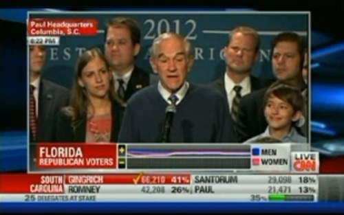 "Love the sweater, Ron Paul. ""We need to restore the Constitution, and we must restore liberty,"" he says."