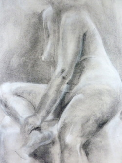 Seated figure, soft light Charcoal and conté on newsprint, 18x24