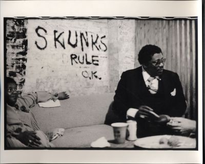 "B. B. King, relaxing before a performance at the late, lamented Club Foot in Austin, Texas, having chosen a seat according to his preference in Austin legendary rock bands, the Skunks, apparently agreeing with the sentiment that ""The Skunks helped put Austin on the rock n' roll map."" Or maybe that's just where he felt like sitting."