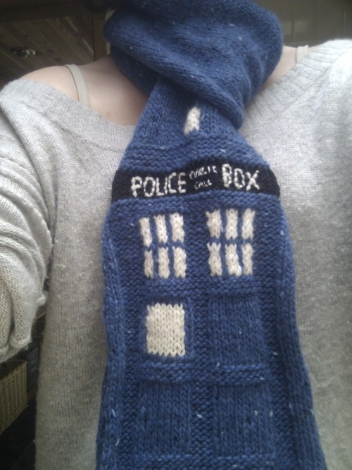 chimunkemu:  My latest adventure in knitting is complete! TARDIS scarf! Not perfect, but considering I made it and the pattern myself I'm pretty damn happy. The idea is it can also be worn as a plain blue scarf, then: 1. hear people discussing nerdy things 2. twist scarf around so TARDIS is showing 3. ?????? 4. friendship!