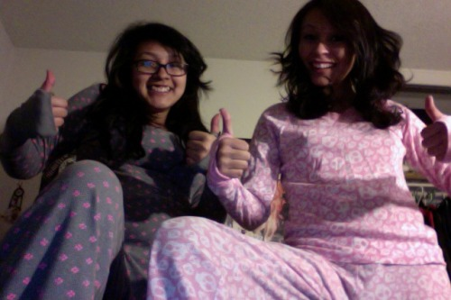 so like last christmas me and sarah got these really ugly pajamas and we usually wear the bottoms only but tonight i suggested we wear the whole set.  twinz and i wasn't wearing a bra. oops