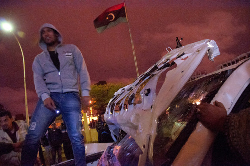 Benghazi on Flickr.Protestors destroy a vehicle said to belong to NTC Chairman Mustafa Abd-al-Jalil outside the NTC HQ in Benghazi.