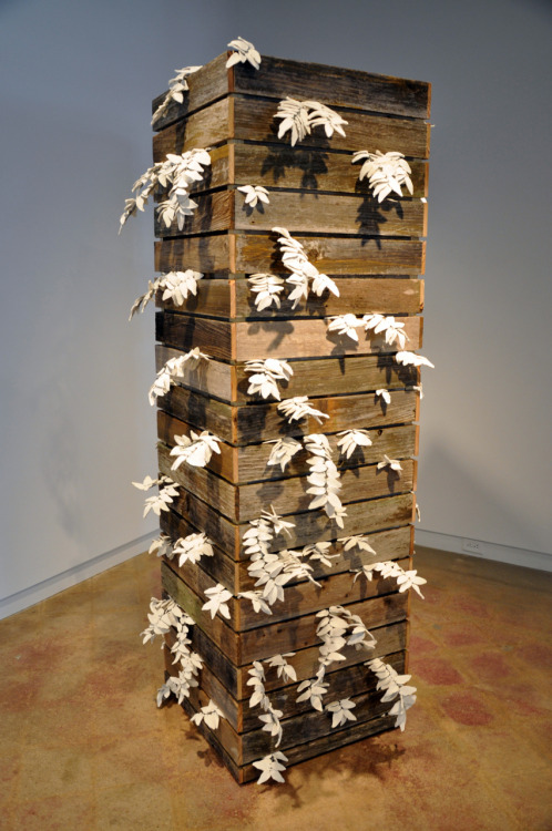 Marianne McGrath: Fenced, 2011, porcelain, wire, reclaimed wood, 7'h x 3'1 x3'd