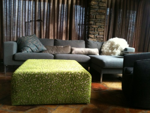 Designer's Guild custom built ottoman, ripple fold drapes and scatter cushions comfy up the rec room.
