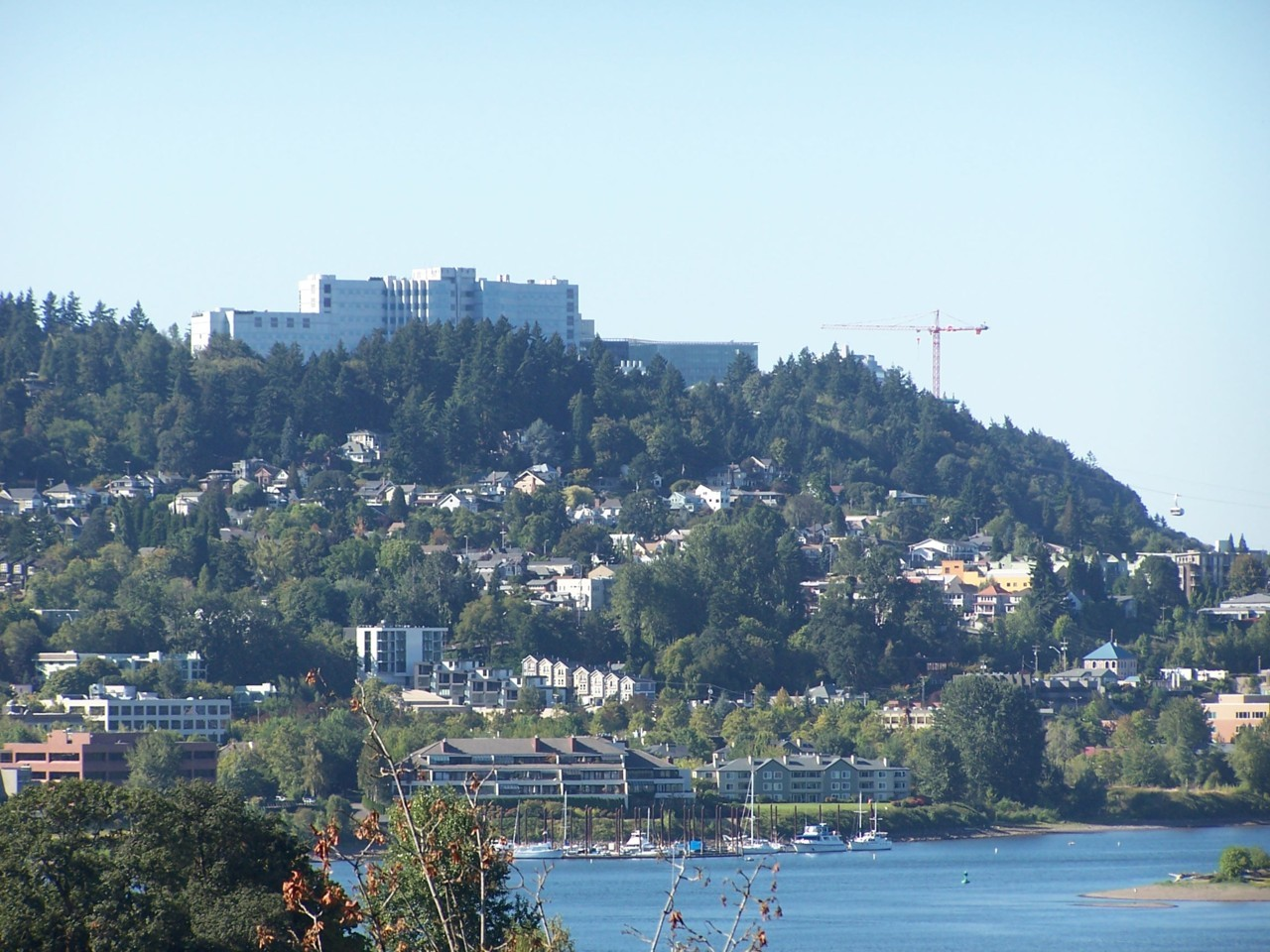 John's Landing and Marquam Hill, capped by the VA Hospital and OHSU. The Portland Aerial Tram is visible at the far right.