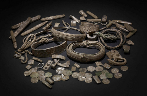 homoarchaeologicus:  Silverdale viking hoard, British Museum.  The hoard comprises of 27 coins, 10 complete arm-rings of various Viking-period types, 2 finger rings and 14 ingots (metal bars), as well as 6 bossed brooch fragments, a fine wire braid and 141 fragments of chopped-up arm-rings and ingots, collectively known as 'hacksilver'.