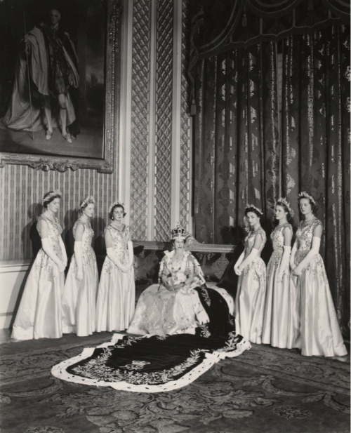 video-et-taceo:  The Coronation - Queen Elizabeth II with her Maids of Honour -Cecil Beaton -Gelatin silver print -2 June 1953 In selecting six Maids of Honour instead of pages to bear her velvet train throughout the Coronation ceremony, the Queen followed the precedent of Queen Victoria. From left to right, they were: Lady Moyra Hamilton (now Lady Moyra Campbell), Lady Anne Coke (now The Rt Hon The Lady Glenconner), Lady Rosemary Spencer-Churchill (now Lady Rosemary Muir), Lady Mary Baillie-Hamilton (now Lady Mary Russell), Lady Jane Heathcote-Drummond-Willoughby (now The Rt Hon The Baroness Willoughby de Eresby), Lady Jane Vane-Tempest-Stewart (now The Rt Hon The Lady Rayne)