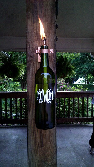 I love this personalized wine bottle lantern sold on Etsy by Monograms Markings and More.  Yet another thing you can do with a wine bottle!